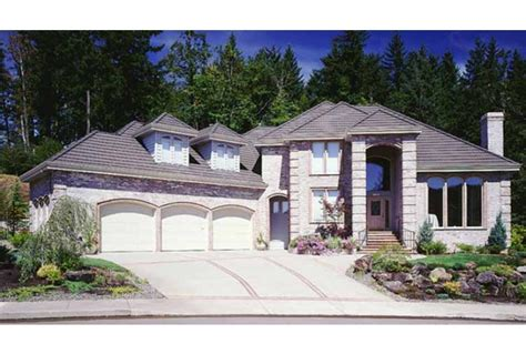 house plans with three car garage eplans mediterranean house plan three car garage 3448