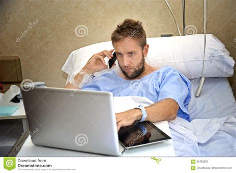working from bed workaholic business man in hospital room lying in bed sick