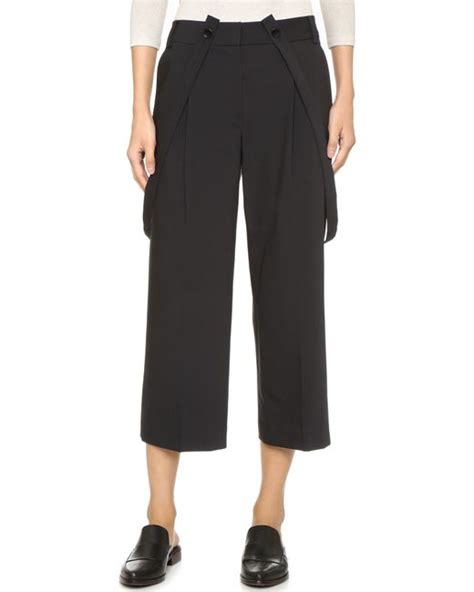 Cropped Suspender tibi cropped with suspenders in black lyst