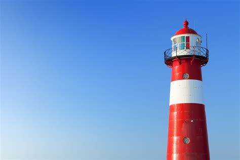 red  white lighthouse   clear blue sky blue