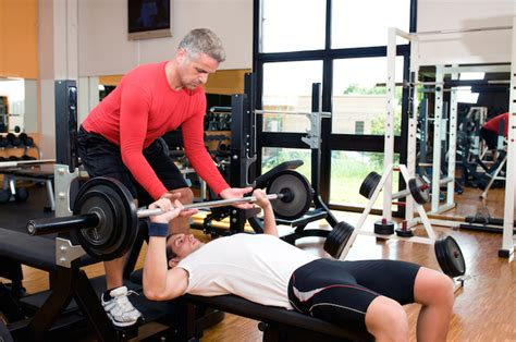 how to lift heavy bench press how to spot someone for the bench press