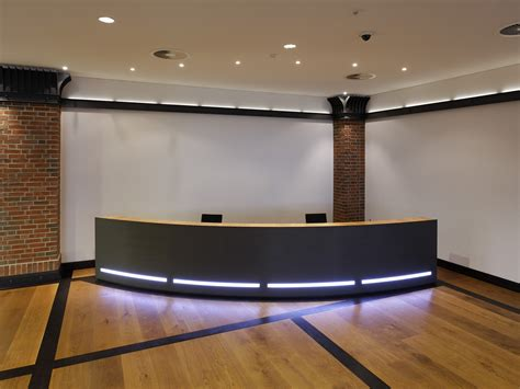 Reception Desk With Built In Lights Industriale By Plan W