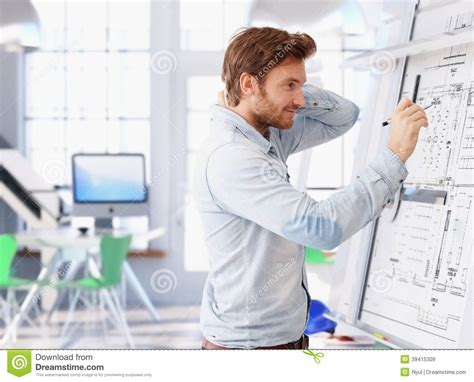 designers and architects young architect working at drawing board stock photo