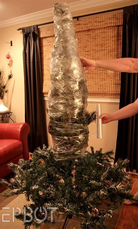 tree hacks holiday hack how to shrink wrap your christmas tree