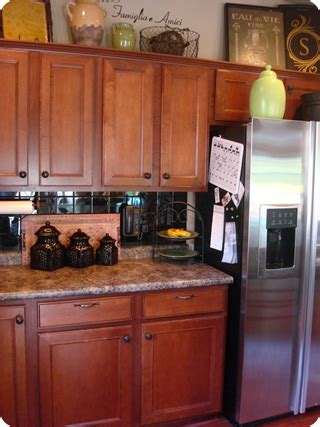 Ideas For Decorating Above Kitchen Cabinets by Decorating Ideas For The Top Of Kitchen Cabinets Pictures