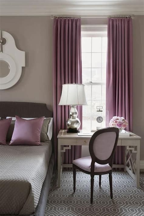 gray  purple bedroom features walls painted warm gray lined   gray bed dressed  gray