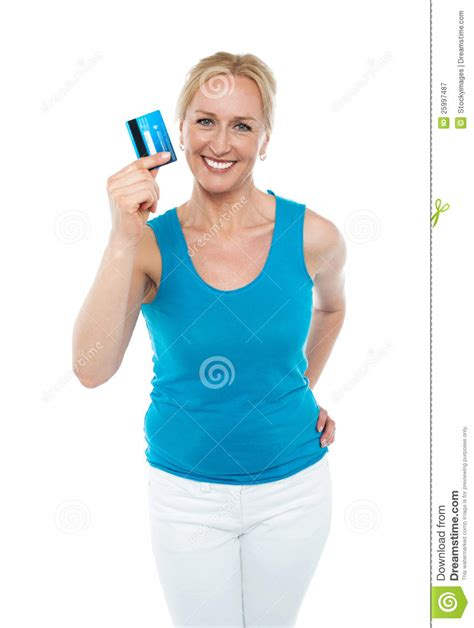 middle age trendy clothing trendy middle aged woman showing credit card royalty free