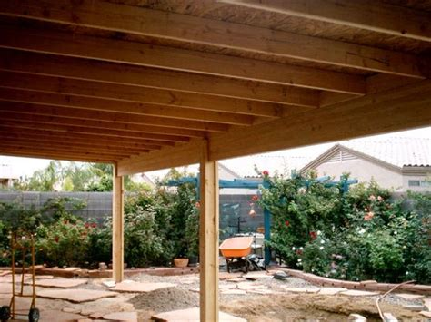 A Solid Roof Patio Cover Under Construction Covered Wood Patio Designs