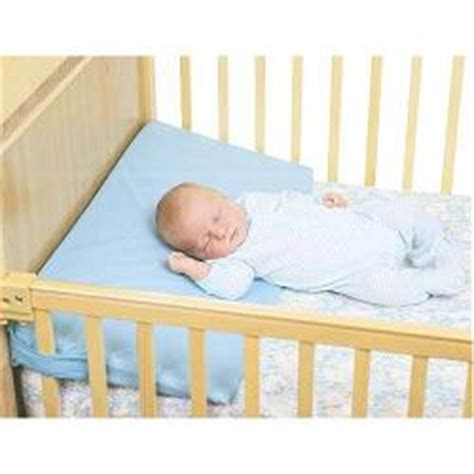 swaddling a baby with reflux and babies