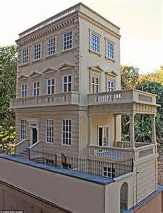 collector house inside bespoke dolls house complete with flickering
