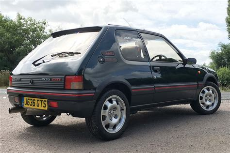 pug 205 gti peugeot 205 gti 1 6 vs peugeot 205 gti mi16 retro road test motoring research