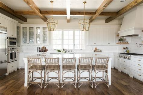 sophisticated farmhouse style kitchen  wood beams