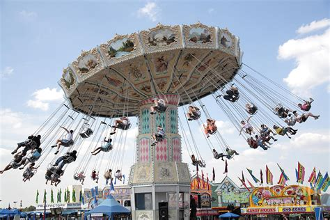 swings at the fair swing carousel at county fair photograph by william kuta