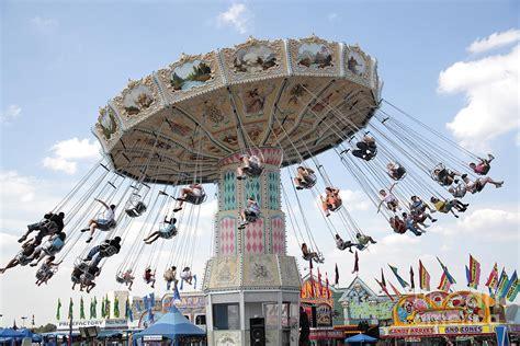fair swings swing carousel at county fair photograph by william kuta