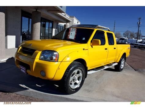 yellow nissan truck 2002 nissan frontier sc crew cab 4x4 in solar yellow photo
