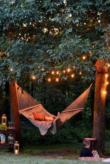 Backyard Themes by Decorating With Outdoor Lights To Romanticize Backyard Designs