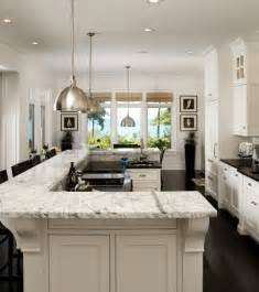 white kitchen cabinets with dark floors dark floors white cabinets and carerra marble this is