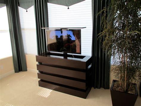 bedroom tv lift cabinet le bloc tv lift cabinet in a beautiful modern bedroom