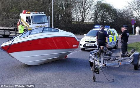 xpress boat trailer problems 16ft speedboat falls off the back of a trailer at busy