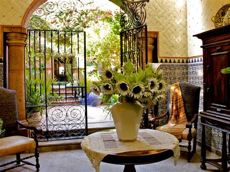 photos hgtv spanish hacienda style foyer with terra cotta tile this spanish style entrance features a metal gate arched