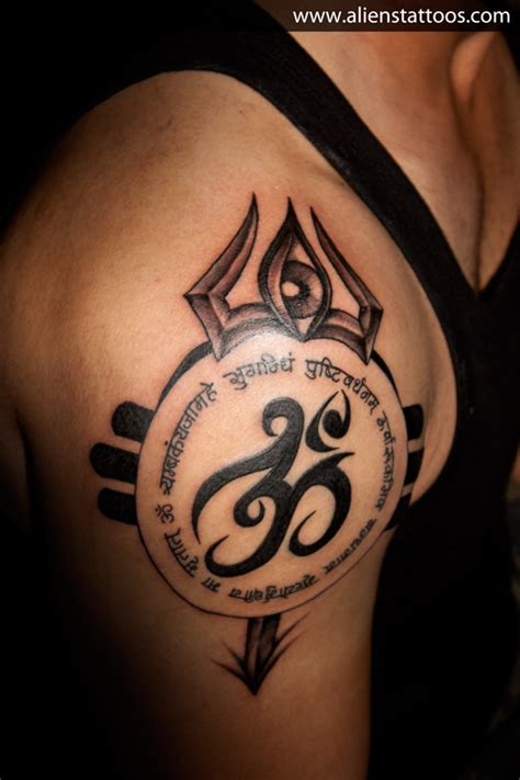 tribal om tattoo om with mantra trishul inked by at aliens