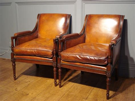 sold pair of studded leather library reading armchairs
