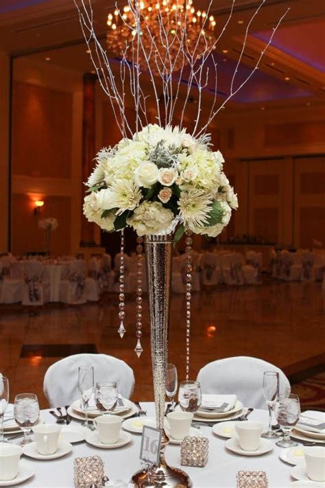 tall centerpieces on pinterest tall centerpiece wedding winter wedding centerpiece on tall silver vase with silver