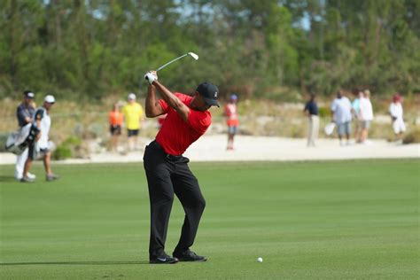tiger woods back swing what is tiger woods doing with his swing now and should