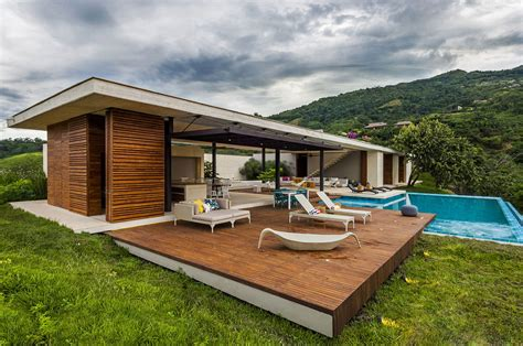modern country home in colombia adorns the landscape with