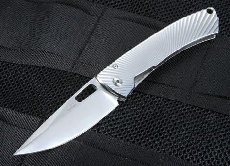 titanium folding knife lionsteel tispine polished titanium folding knife elmax