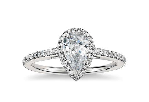 pear shaped halo cubic zirconia engagement ring in 14k
