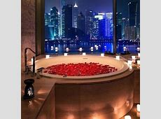 bath with red roses and candles and a beautiful view of ... Rose Petals And Candles Ideas