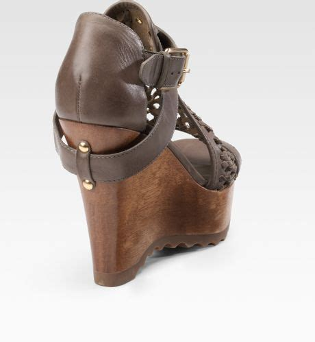 Sandal Wanita Couture Wedges couture bundy wovenleather wedge sandals in brown bronze lyst