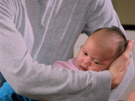 how to a baby how to hold a baby babycenter