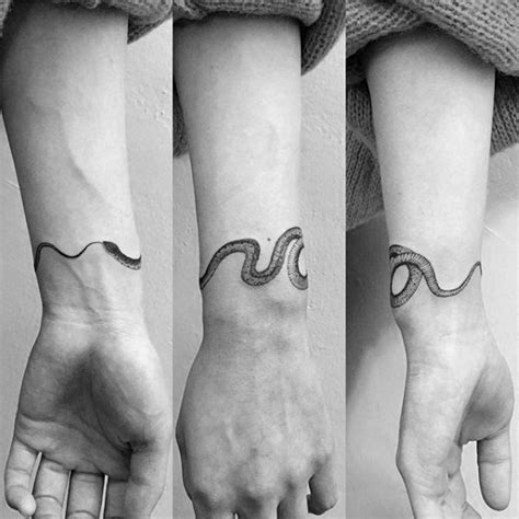snake tattoo on wrist 75 ouroboros designs for circular ink ideas