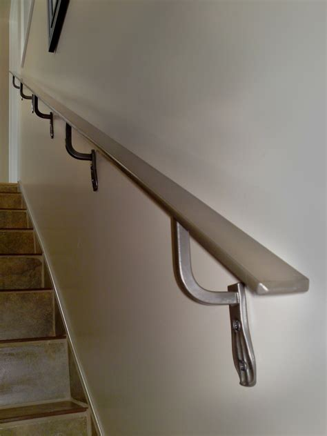 Metal Wall Mounted Stair Handrail Photos Hgtv Sleek Modern Staircase With Steel Cable