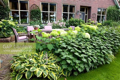 Secret Annabelle In Japan 12281a gap gardens dining area next to house with border of
