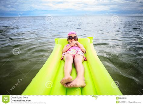 little girl tube top pictures free download little girl laying on tube swimming stock image image of