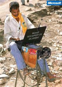 Tech support worker grinding bicycle in indian tech support center