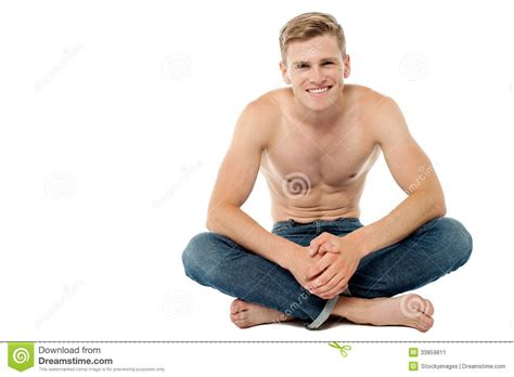 2 Floor Bed by Shirtless Man Sitting On The Floor Stock Image Image