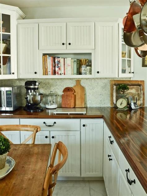 white kitchens with butcher block like white cabinets beadboard look and dark butcher block