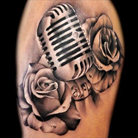 microphone tattoo meaning realistic microphone and roses tattoo done in black and