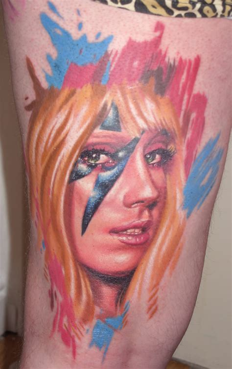 lady gaga s tattoos colorful of gaga s on mans leg