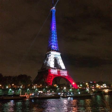 eiffel tower light up as mourns terrorist attacks eiffel tower lights up