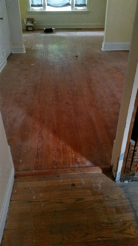 help with transition between new and hardwood floors