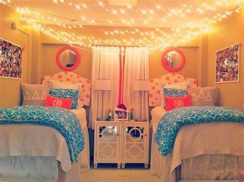 dorm ideas dorm room hanging string lights across ceiling pink and