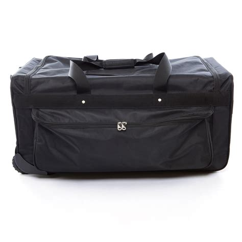 Suitcase With Garment Rack by The Caddy Bag Is The Ultimate Duffel With Wheels And A