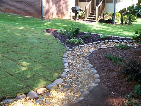 River Rock Landscaping Ideas with River Rock Flower Bed Designs Home Decorating Ideas
