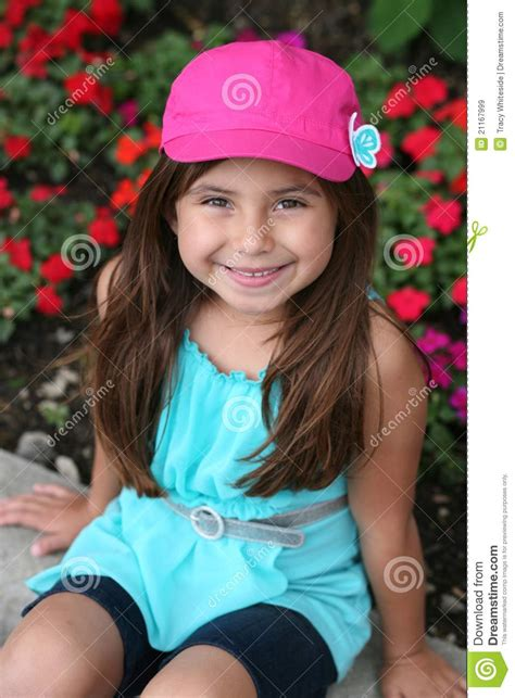 rainpow young little girls cute hispanic little girl in hat royalty free stock images