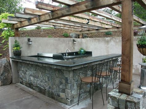 stone bar tops outdoor kitchen cut into slope stone veneer finish with